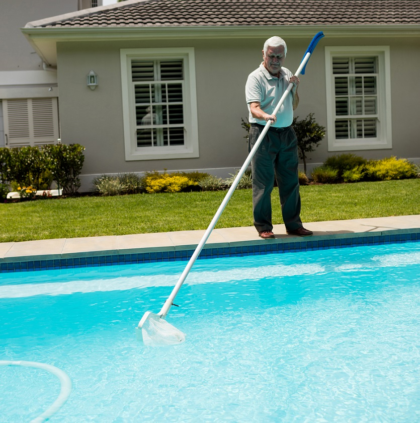 Swimming Pool Treatment Service : Senior man cleaning swimming pool service phoenix